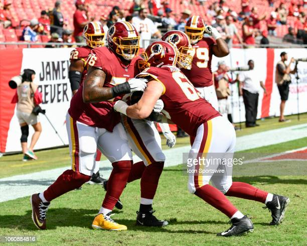 Washington Redskins tackle Morgan Moses and Washington Redskins center Luke Bowanko warm up prior to the first half of an NFL game between the...