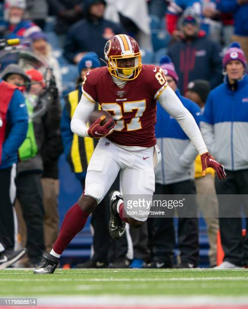 Washington Redskins Tight End Jeremy Sprinkle runs with the ball after a catch during the second half of the National Football League game between...
