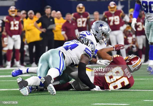 Washington Redskins tight end Jordan Reed is hit hard while catching the ball by Dallas Cowboys middle linebacker Jaylon Smith and Dallas Cowboys...
