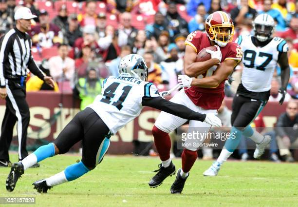 Washington Redskins tight end Jordan Reed pulls in a first down reception against Carolina Panthers defensive back Captain Munnerlyn on October 14 at...