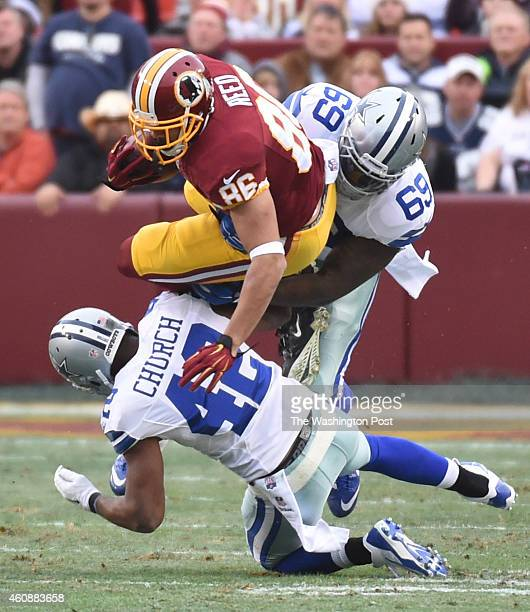 Washington Redskins tight end Jordan Reed tries to get by Dallas Cowboys free safety Barry Church and Dallas Cowboys defensive tackle Henry Melton in...