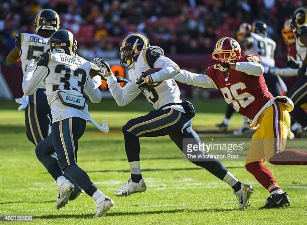 Washington Redskins tight end Jordan Reed tries to tackle St Louis Rams free safety Rodney McLeod after McLeod intercepted a pass intended for...