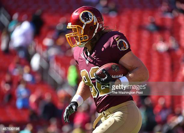 Washington Redskins tight end Logan Paulsen carries the ball during warmups before their game against the Tennessee Titans at FedEx Field on October...