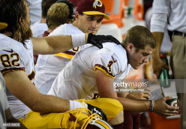 Washington Redskins tight end Logan Paulsen consoles Washington Redskins kicker Zach Hocker after his missed a 39 yard field goal in the fourth...