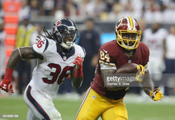 Washington Redskins tight end Niles Paul runs after the catch he was caught by Houston Texans strong safety DJ Swearinger who stripped the ball from...