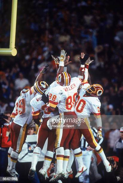 Washington Redskins' tIght end Rick Walker jumps in celebration with his teammates after scoring against the Miami Dolphins during Super Bowl XVII at...