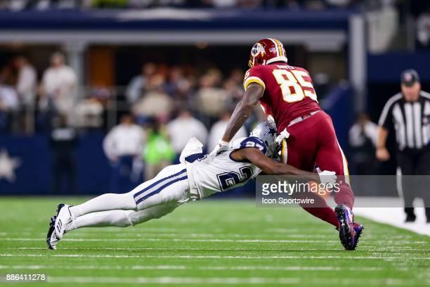Washington Redskins tight end Vernon Davis is hit by Dallas Cowboys cornerback Jourdan Lewis during the Thursday Night Football game between the...