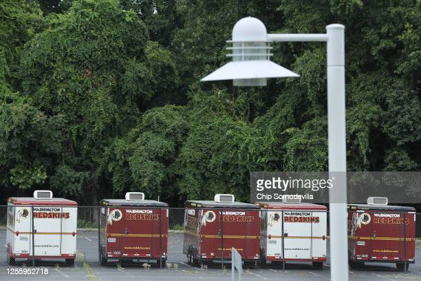 Washington Redskins trailers with the team's logo are parked outside of FedEx Field July 13 2020 in Landover Maryland The team announced Monday that...
