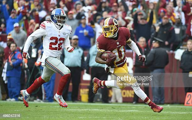 Washington Redskins wide receiver DeSean Jackson heads for the end zone and touchdown pursued by New York Giants strong safety Brandon Meriweather in...
