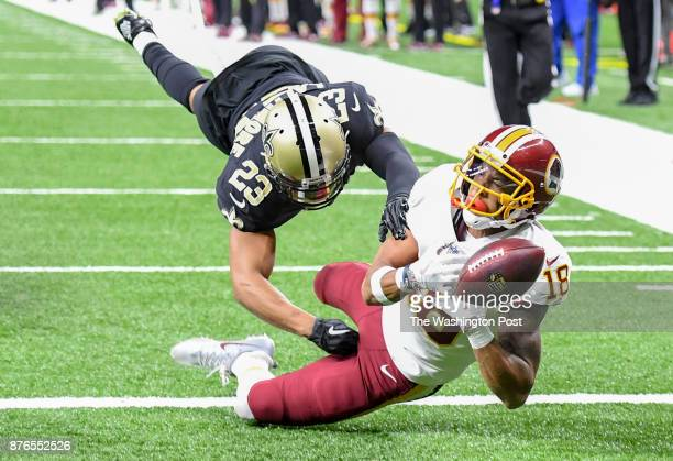 Washington Redskins wide receiver Josh Doctson can't hang onto a pass in the end zone with New Orleans Saints cornerback Marshon Lattimore defending...