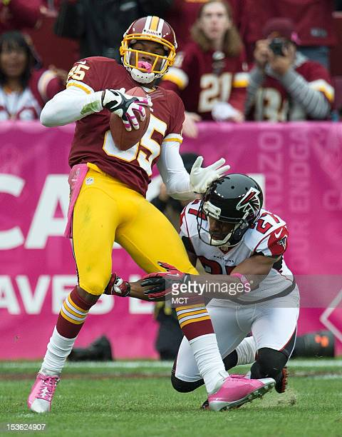Washington Redskins wide receiver Leonard Hankerson is tackled by Atlanta Falcons defensive back Robert McClain during the first half at FedEx Field...