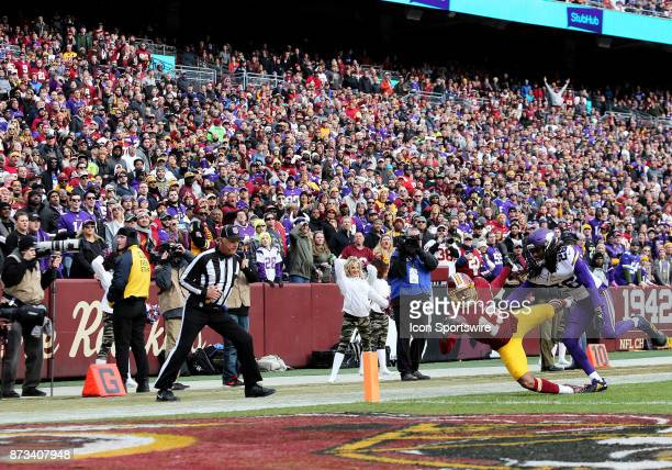 Washington Redskins wide receiver Maurice Harris hauls in a touchdown over Minnesota Vikings cornerback Trae Waynes during a match between the...