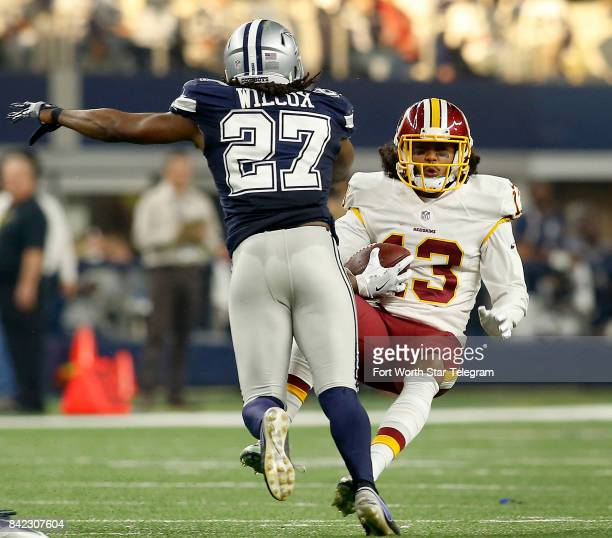 Washington Redskins wide receiver Maurice Harris is knocked down after a hit from Dallas Cowboys strong safety JJ Wilcox in the first half on...