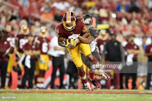 Washington Redskins wide receiver Maurice Harris is tackled by Tampa Bay Buccaneers cornerback Jonathan Moxey after a reception during an NFL...