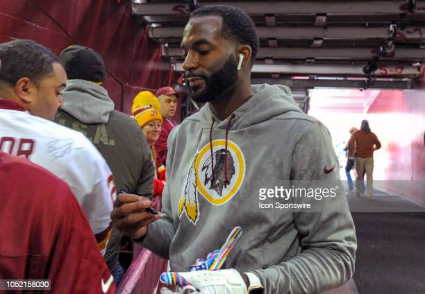 Washington Redskins wide receiver Paul Richardson signs autographs for fans prior to the game on October 14 at FedEx Field in Landover MD The...
