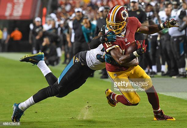 Washington Redskins wide receiver Rashad Ross is taken down by Jacksonville Jaguars cornerback Demetrius McCray after a two yard completion during...