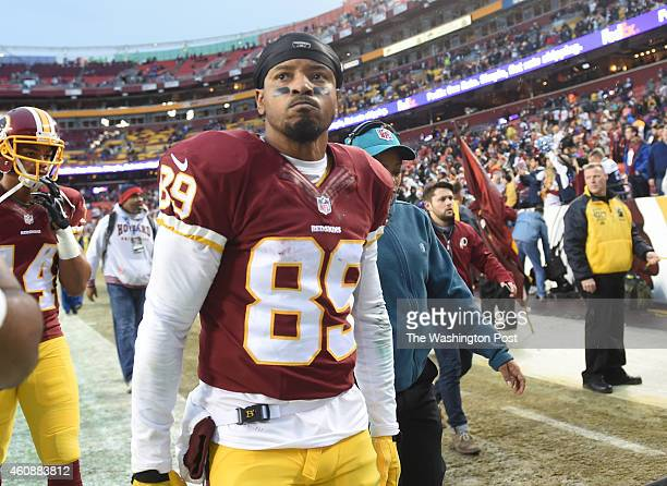 Washington Redskins wide receiver Santana Moss leaves the field following their 4417 loss to the Dallas Cowboys at FedEx field on December 28 2014 in...
