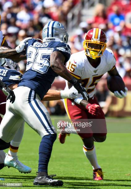 Washington Redskins wide receiver Steven Sims Jr. Makes a reception against Dallas Cowboys free safety Xavier Woods on September 15 at FedEx Field in...