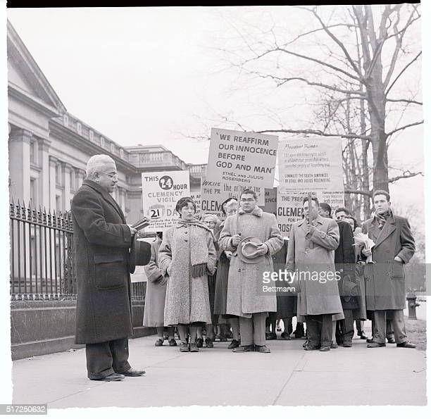 Rosenberg Pickets End Vigil Rev Harold S Williamson of the church of the Rugged Cross N Y leads a group of pickets in a short prayer Jan 17 before...