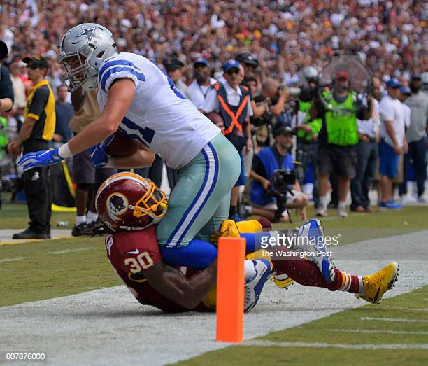 Washington safety David Bruton Jr brings down Dallas tight end Geoff Swaim just short of the goal line in the third quarter as the Washington...