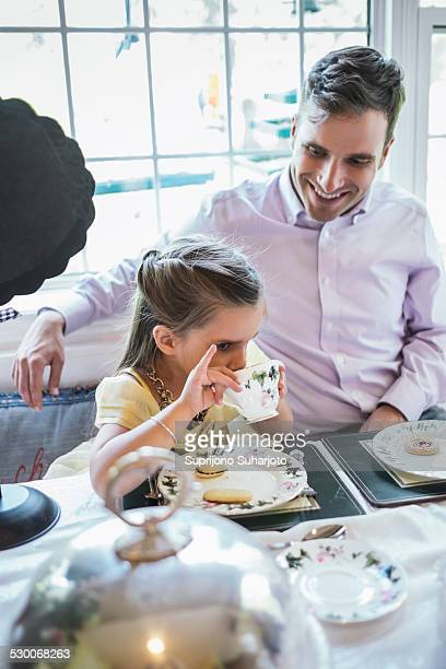 USA, Washington, Seattle, Father and daughter (4-5) eating together in dining room