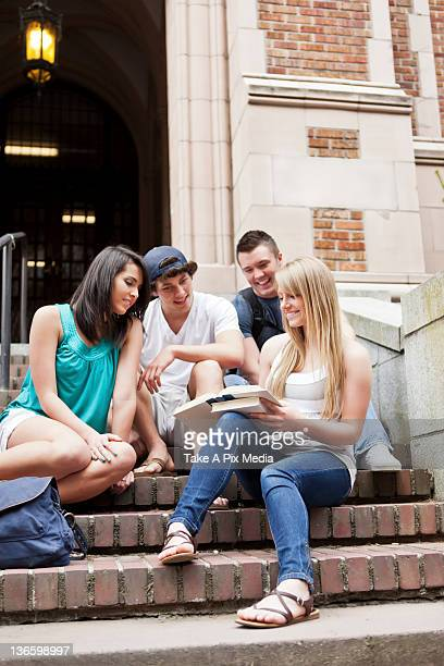 USA, Washington, Seattle, Four college students sitting on steps