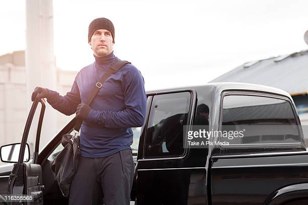 USA, Washington, Seattle, man in workout wear getting out of truck
