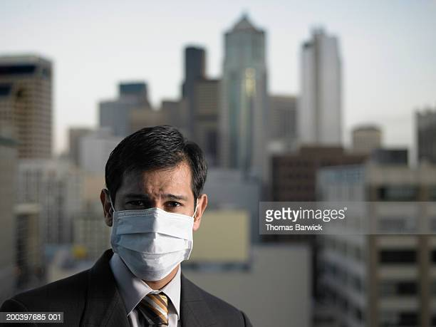 USA, Washington, Seattle, mature businessman wearing surgical mask