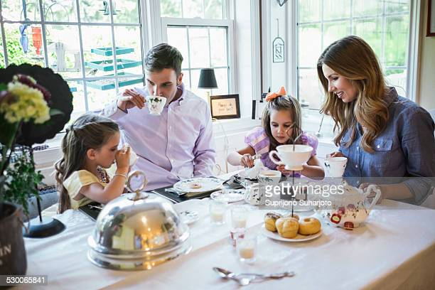 USA, Washington, Seattle, Parents and daughter (4-5) eating together in dining room