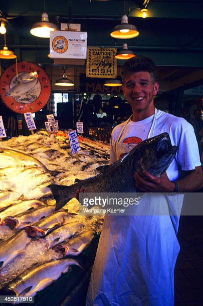 USA Washington Seattle Pike Place Market Pike Place Fish Market Clerk With King Salmon