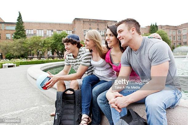 USA, Washington, Seattle, Two couples sitting at fountain