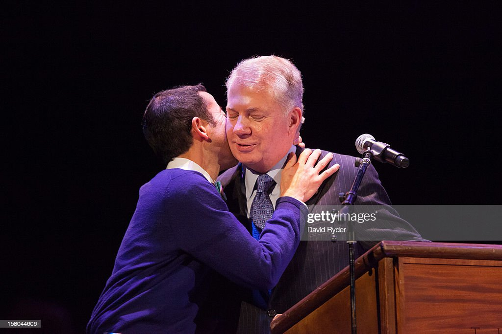 Washington Sen. Ed Murray (D) (R) announces his engagement to his partner Michael Shiosaki during 'A Wedding Reception for All,' which was attended by hundreds and held at the Paramount Theatre on December 9, 2012 in Seattle, Washington. Today is the first day that same-sex couples can legally wed in Washington state. Murray is heavily involved in pushing for LGBT civil rights legislation.