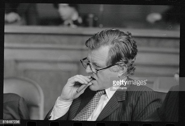 Sen Edward Kennedy DMass chews on a cigar at a hearing of his Senate Judiciary Committee as short while after a woman entered his office and scuffled...