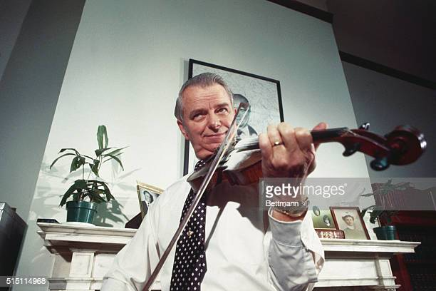 Sen Robert Byrd of West Virginia jokes a bit as he plays the violin for members of his staff after he announced he was a candidate for the Democratic...