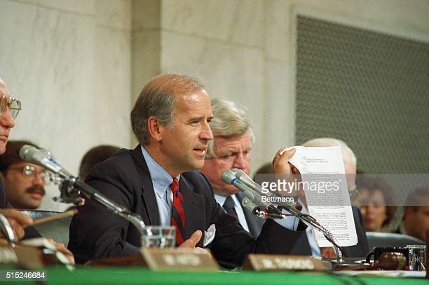 Senate Judiciary Committee Chairman Joseph Biden DDel holds up a copy of the FBI report on Anita Hill during committee hearings on Capital Hill as...