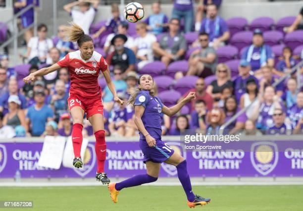 Washington Spirit defender Estelle Johnson heads the ball as Orlando Pride forward Marta Viera Da Silva toys to make a play During the NWSL soccer...