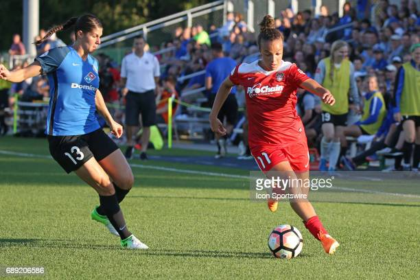 Washington Spirit forward Mallory Pugh drives past FC Kansas City defender Brittany Taylor in the first half of an NWSL women's soccer match between...