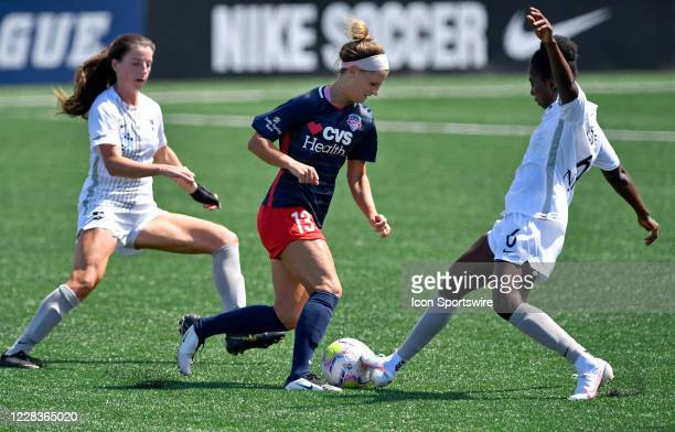 Washington Spirit midfielder Bayley Feist dribbles between Sky Blue forward Paige Monaghan and midfielder Jennifer Cudjoe during the National Womens...