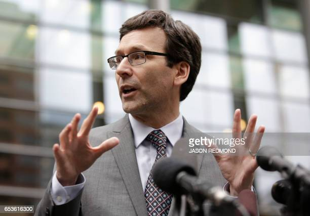 Washington State Attorney General Bob Ferguson address the media following a hearing about US President Donald Trump's travel ban at the US District...
