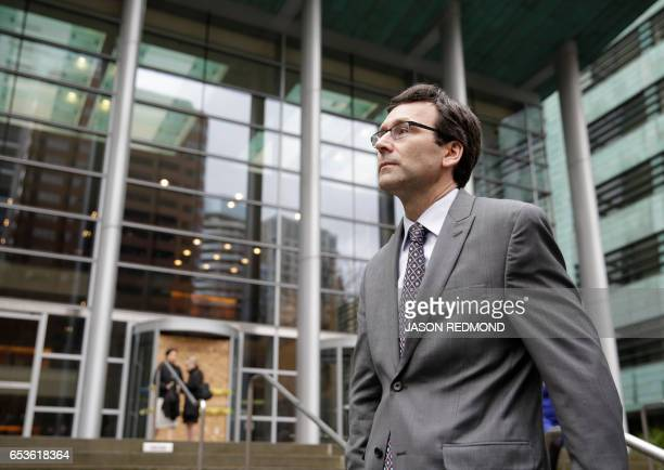 Washington State Attorney General Bob Ferguson waits to addresses the media following a hearing about US President Donald Trump's travel ban at the...