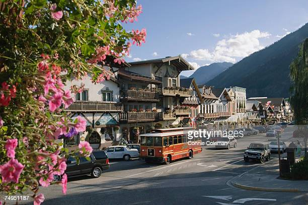 usa, washington state, chelan county, leavenworth, traffic in street near cascade mountains - leavenworth washington stock photos and pictures