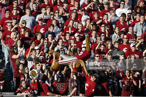 Washington State Cougars fans and their mascot cheer during the game against the Oregon Ducks on October 21 2006 at Martin Stadium in Pullman...