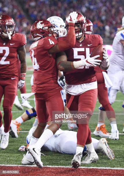 Washington State Cougars linebacker Frankie Luvu is congratulated by defensive back Marcus Strong after recovering a fumble during the game between...