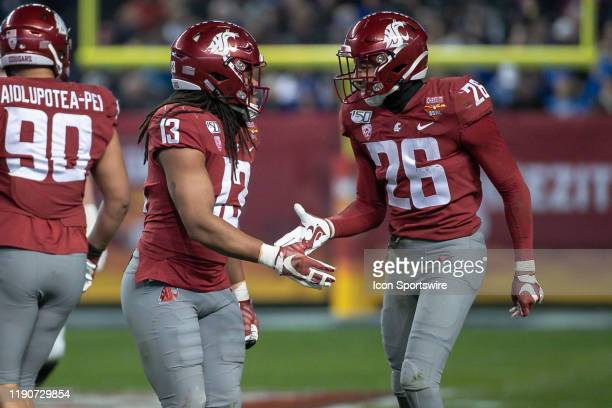 Washington State Cougars linebacker Jahad Woods and Washington State Cougars safety Bryce Beekman react to a big play during the CheezIt Bowl college...