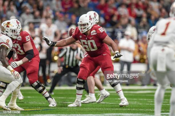 Washington State Cougars offensive lineman Andre Dillard looks to make a block during the Alamo Bowl between the Washington State Cougars and Iowa...