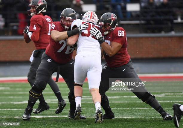 Washington State Cougars offensive lineman Cody O'Connell and lineman Andre Dillard doubleteam Stanford Cardinal defensive end Dylan Jackson during...