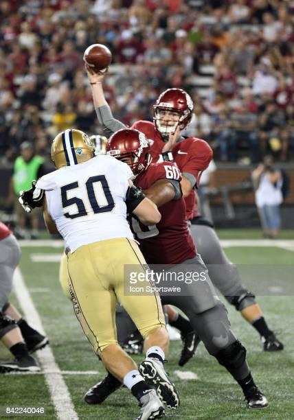 Washington State Cougars quarterback Luke Falk throws a pass as offensive lineman Andre Dillard blocks Montana State Bobcats defensive end Chase...