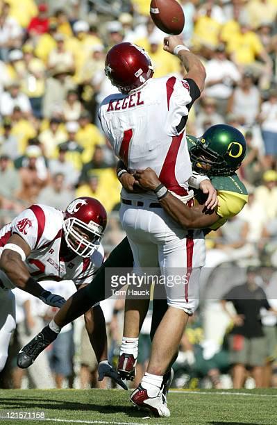 Washington State Cougars quarterback Matt Kegel gets sacked by an Oregon Ducks defender at Autzen Stadium in Eugene Oregon Oregon lost to Washington...