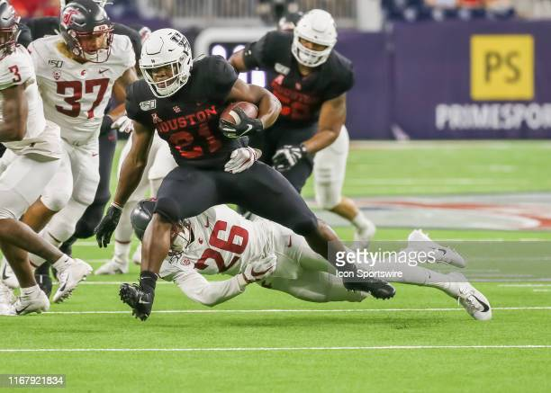 Washington State Cougars safety Bryce Beekman tackles Houston Cougars running back Kyle Porter during the AdvoCare Kickoff college football game...