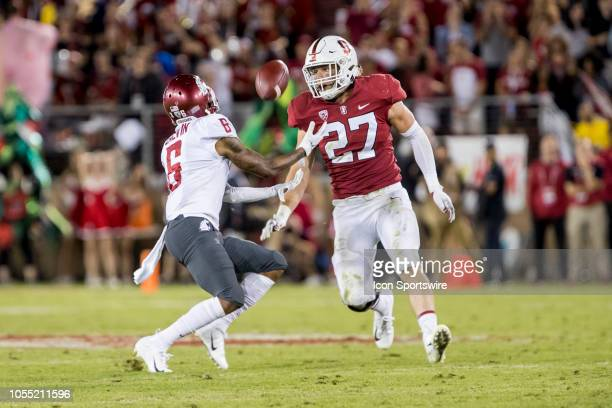 Washington State Cougars wide receiver Jamire Calvin catches a ball just ahead of Stanford Cardinal linebacker Sean Barton during the college...